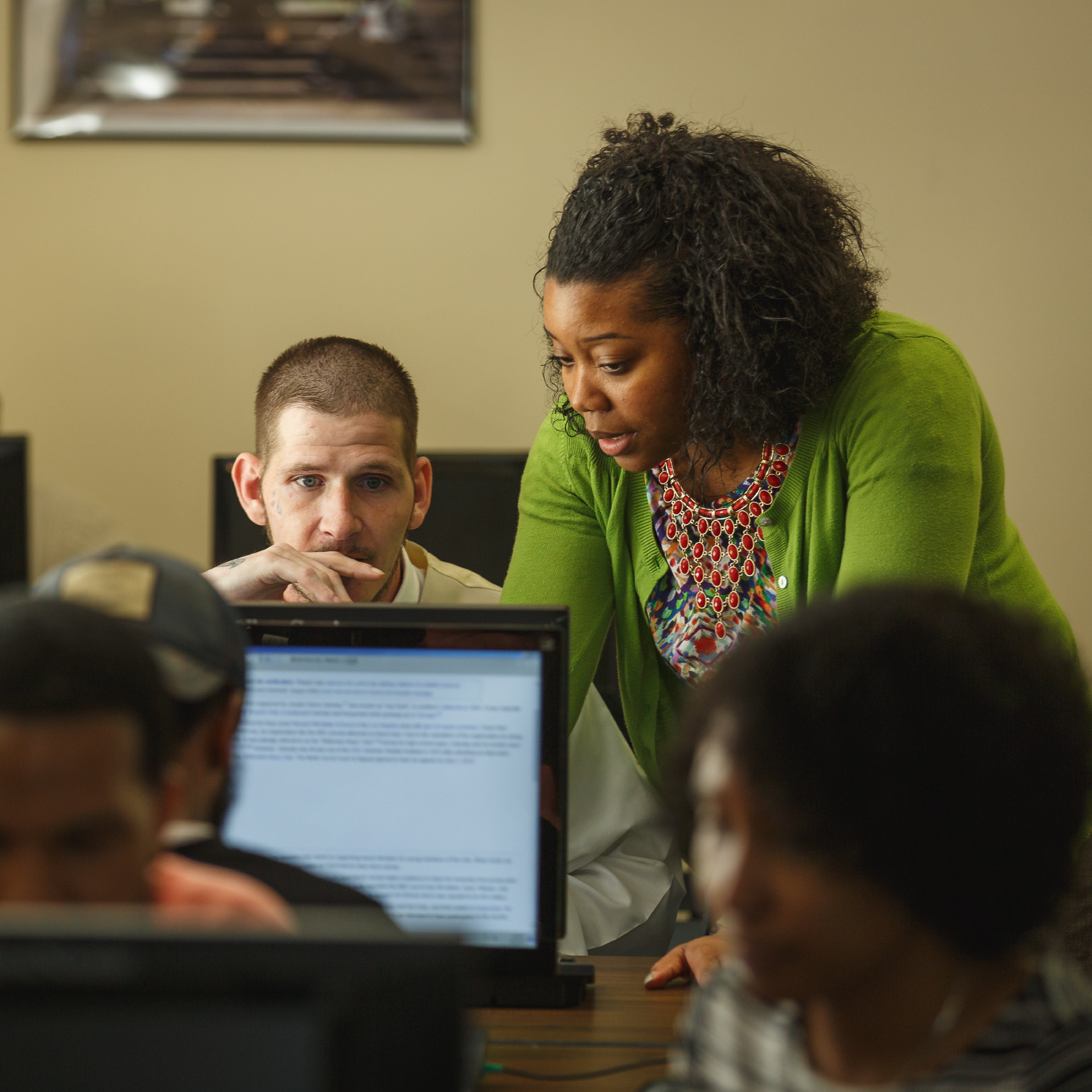 A workforce development participant works with his coach
